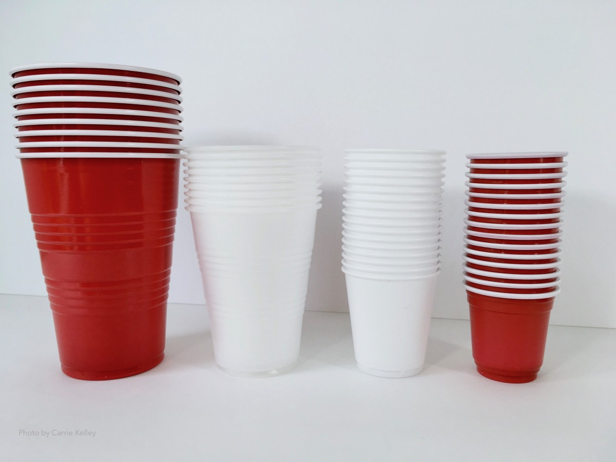 An assortment of plastic cups for pour painting.