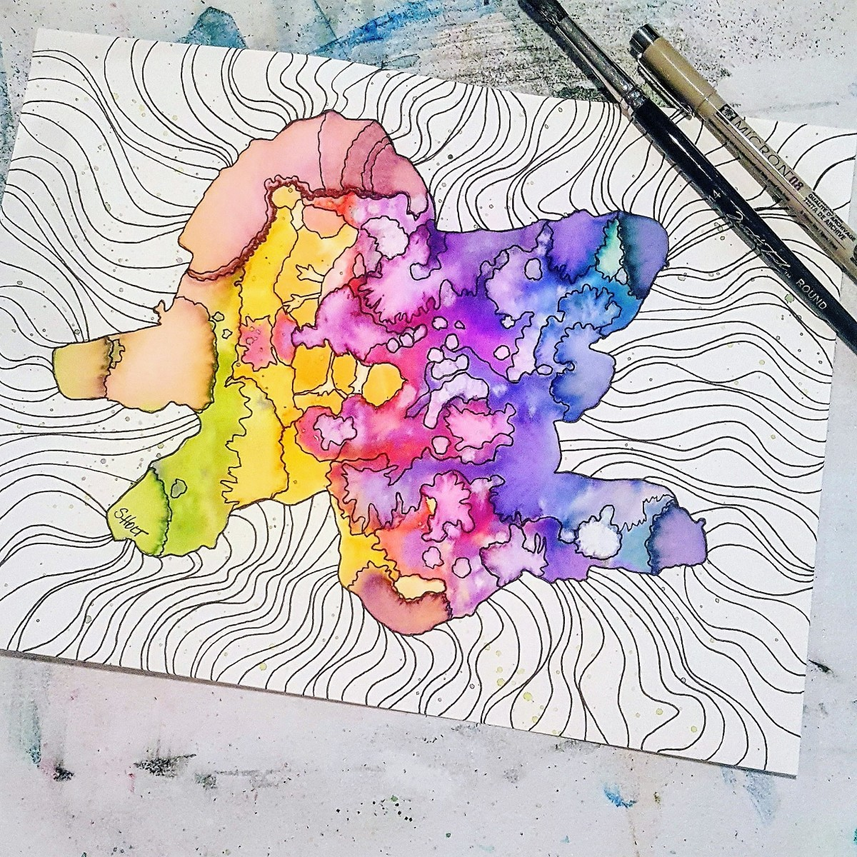 Watercolor created with rainbow colors and micron ink pen.