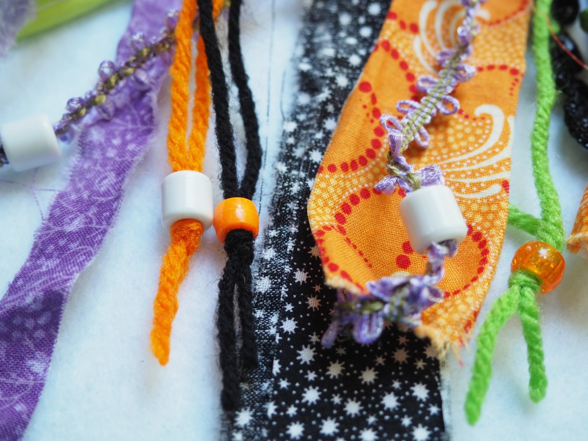 Adding beads to the fabric.