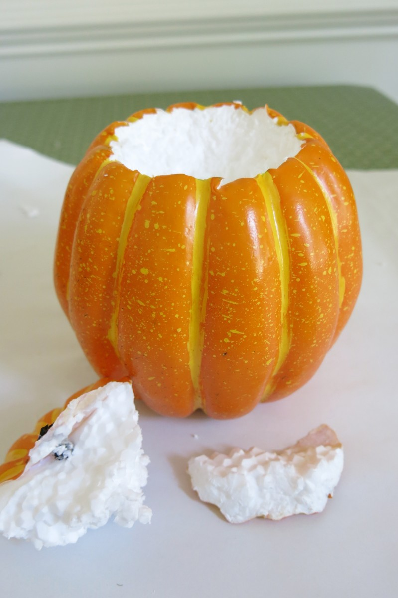 Remove the top of your pumpkin to start making your candle holder