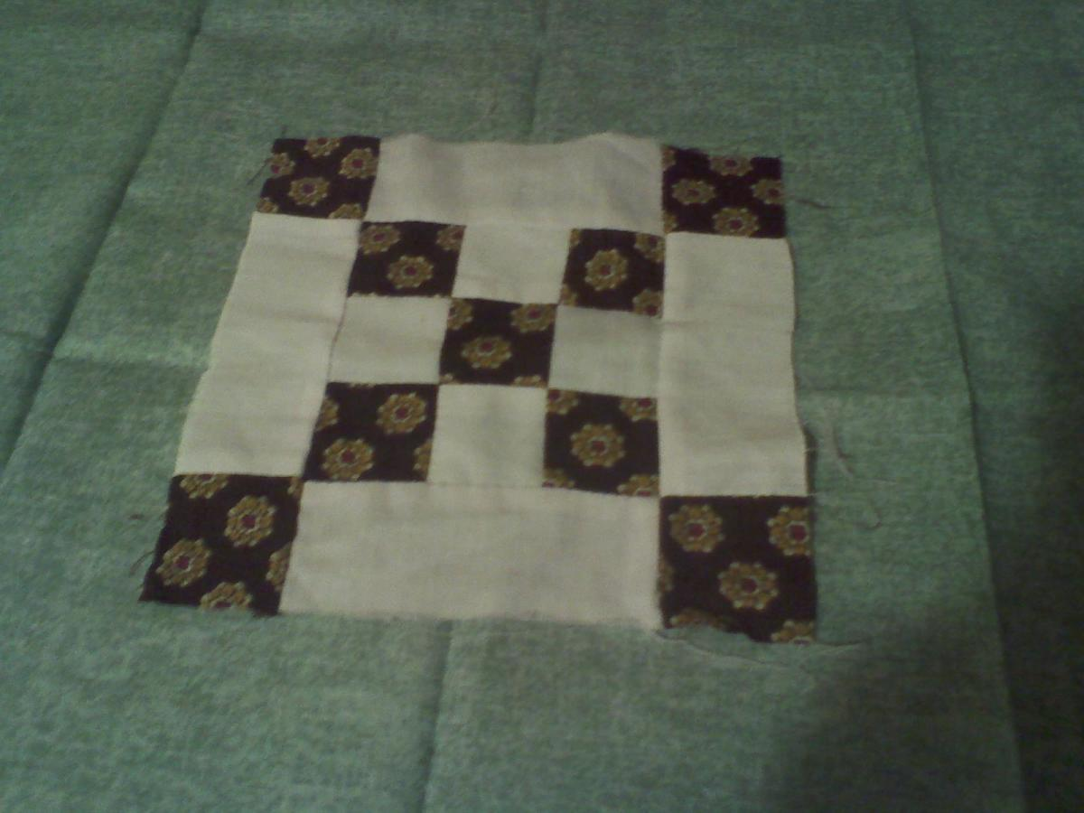 A nine-patch block. This was usually the first pattern given to first time quilters.