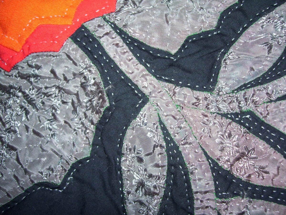 Satin detailing on Medallion quilt