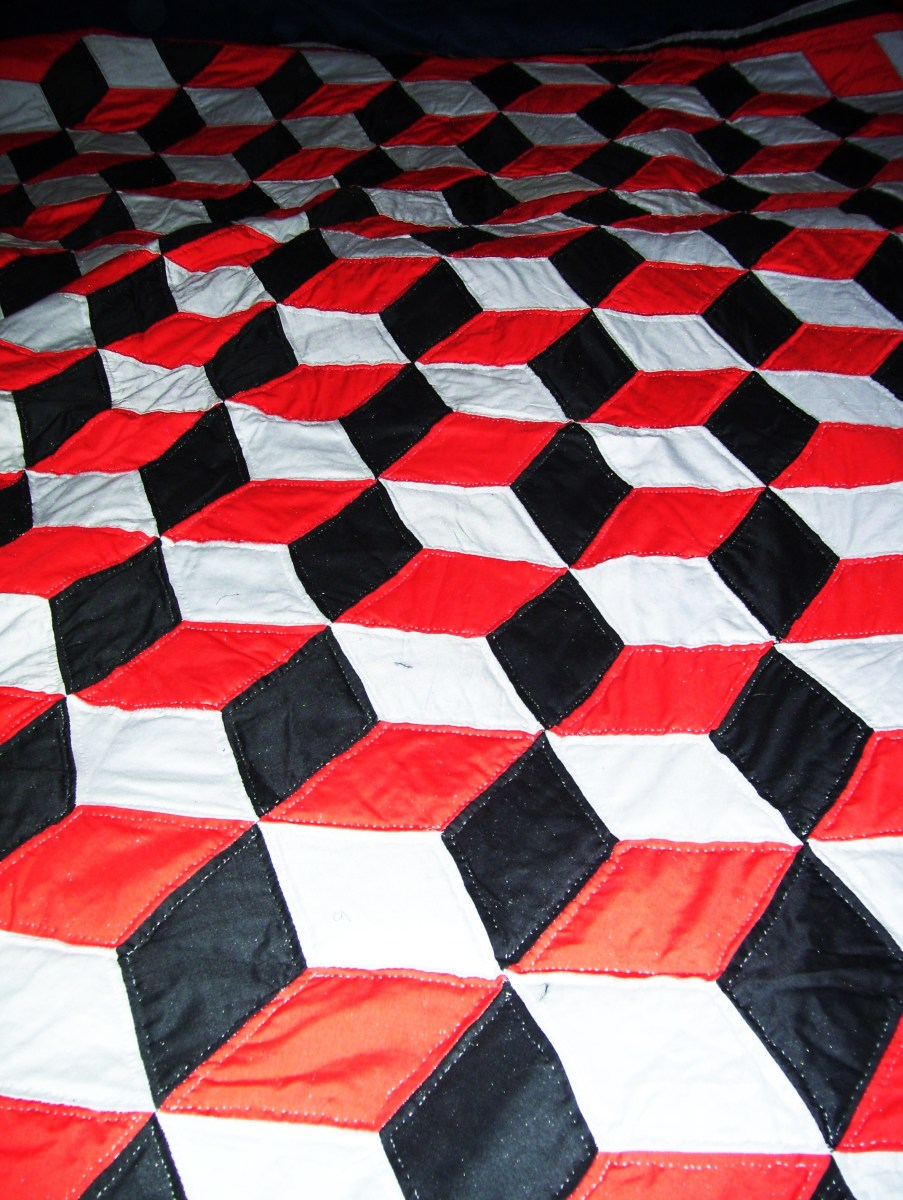 Red, black, and grey baby block quilt. sewn in 2003 by my grandmother.