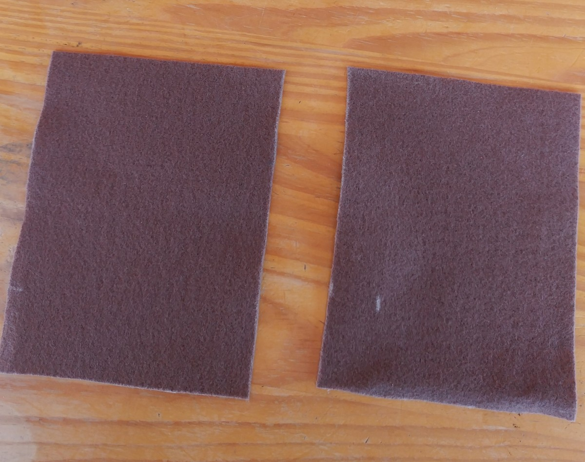 Begin with two square pieces of felt, that is the same size.