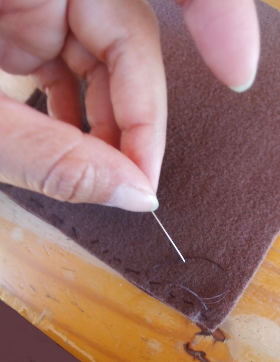 Sew the edges of the felt together.
