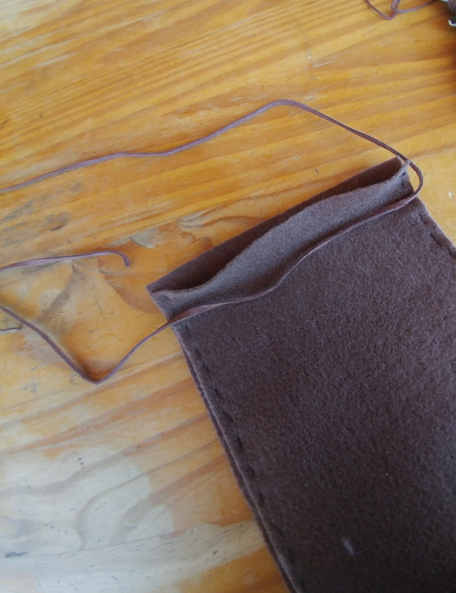 You may use tie cord, string or yarn for the top of bag.