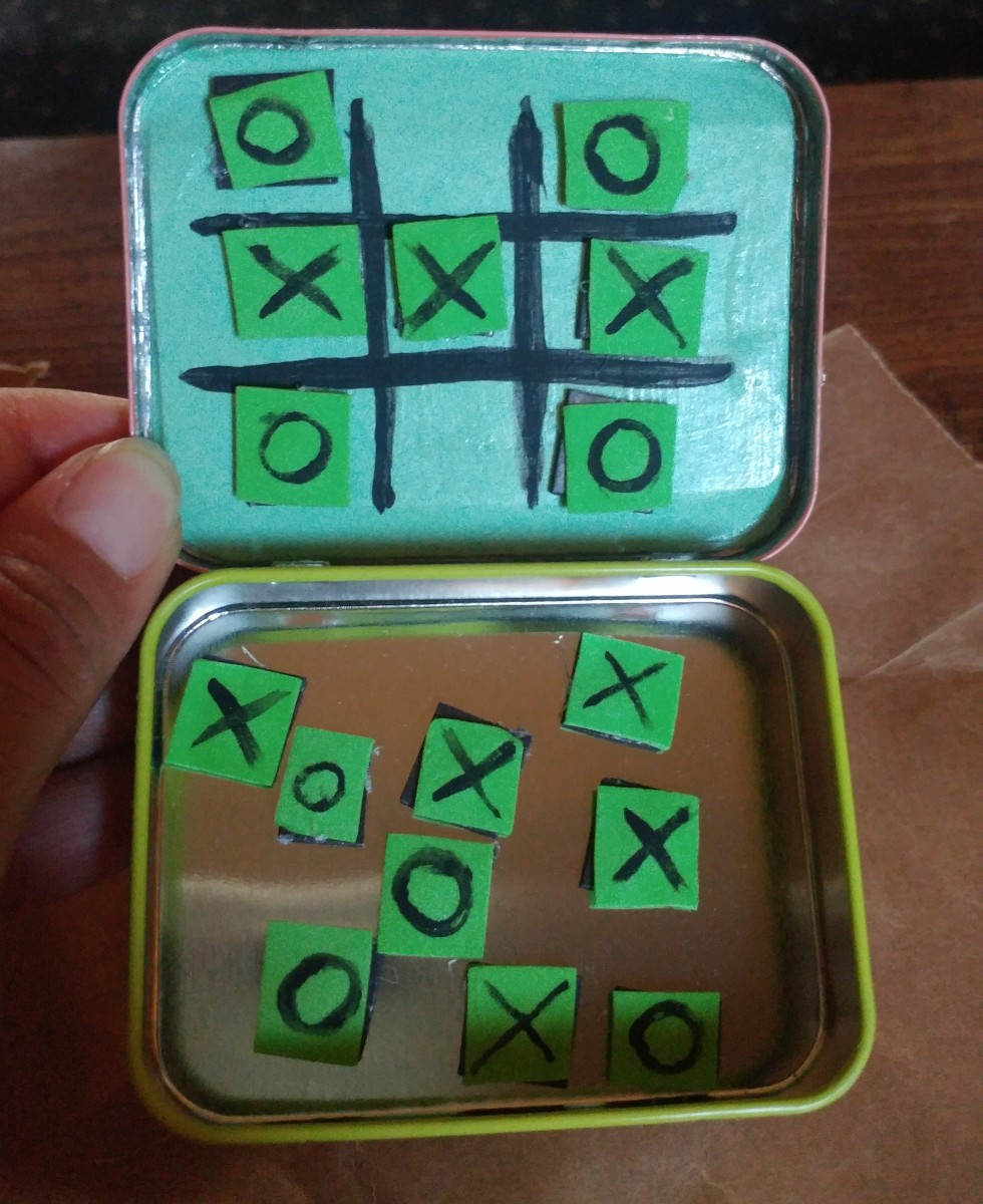 The little squares can be kept inside tin. The squares will stay on the lines during a game, because of the magnets.