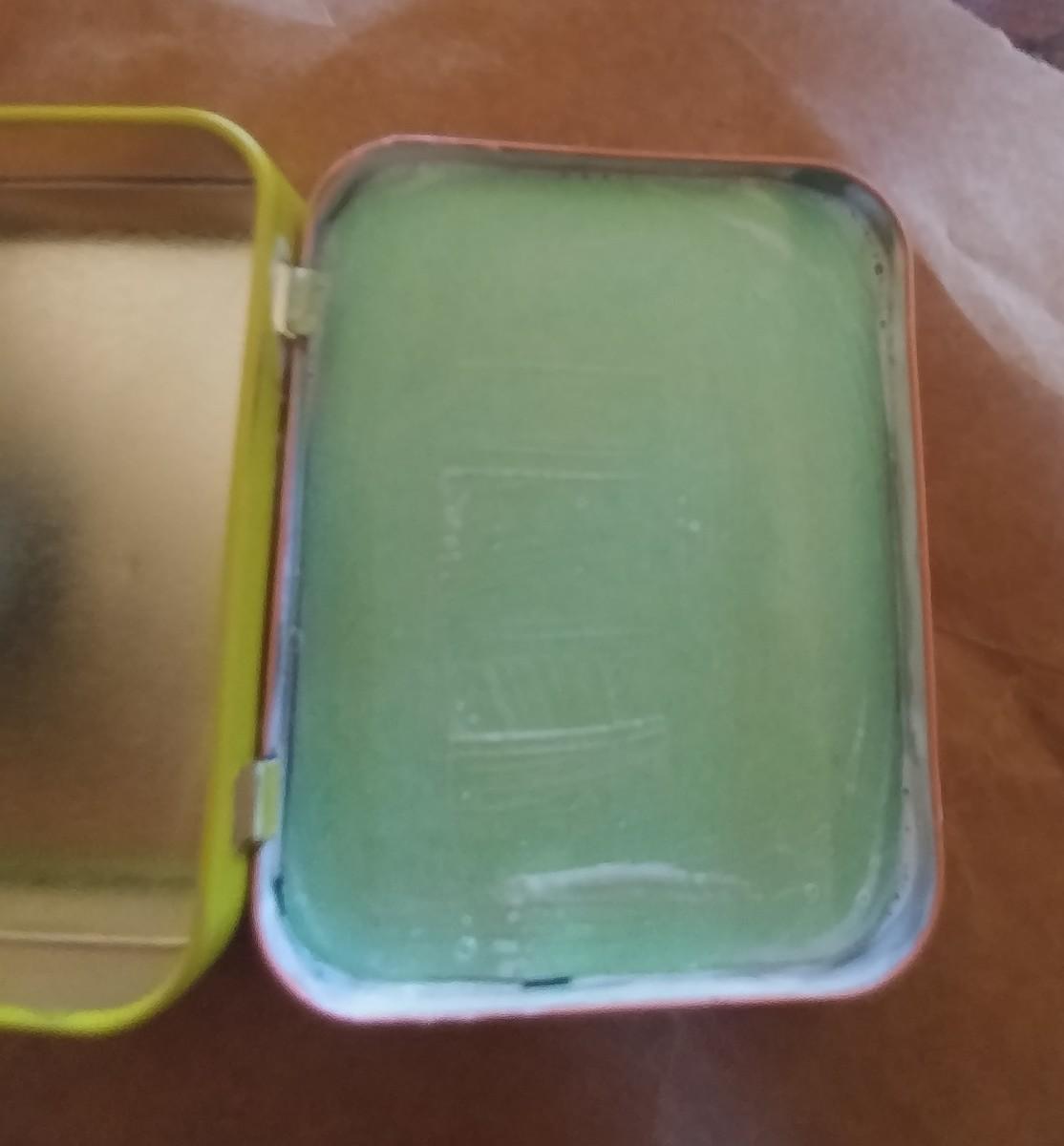 Mod Podge a craft foam over magnet, on the inside of lid.