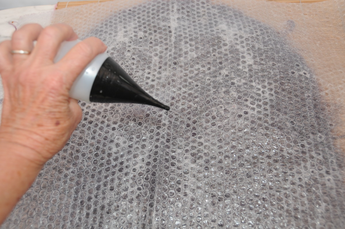 Cover with bubble wrap and wet with warm soapy water.