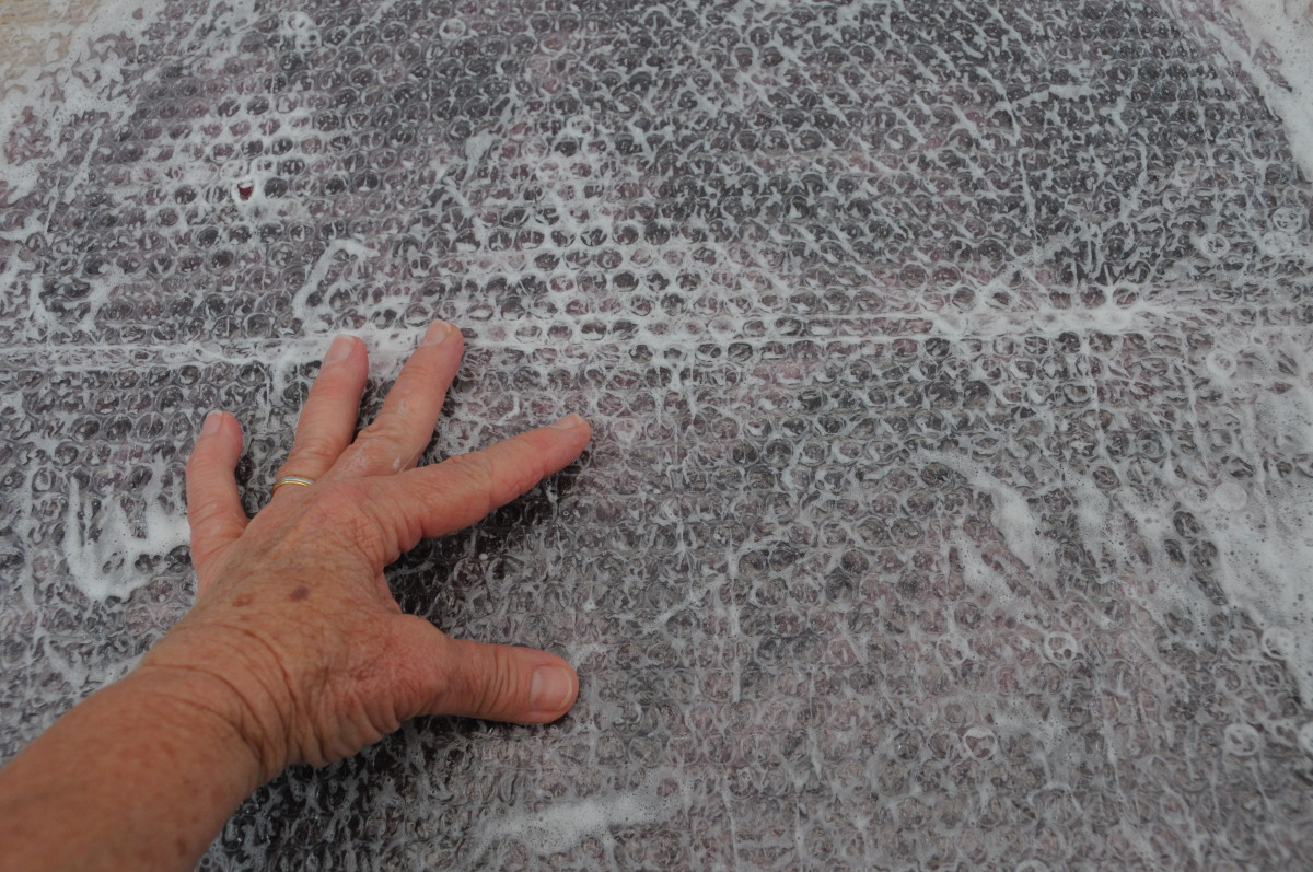Rubbing the surface of the Bubble Wrap