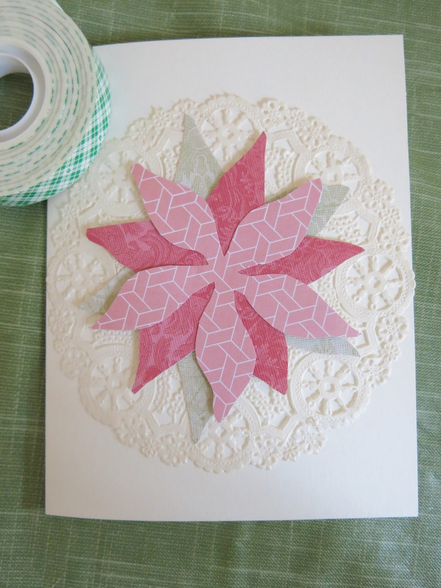 You can use a doily as the background of your handmade card.