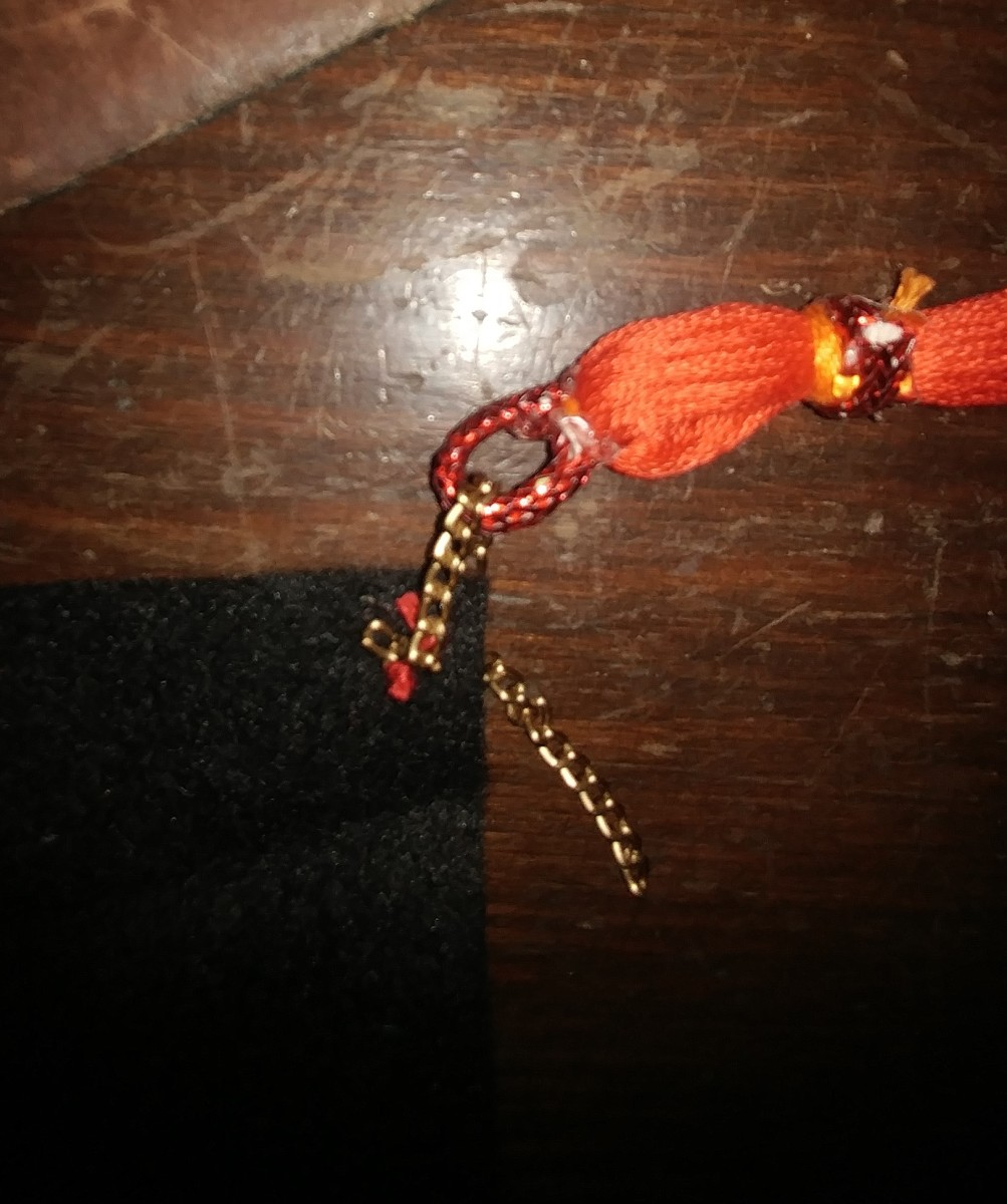 Slip a tassel through, and sew other end of chain.