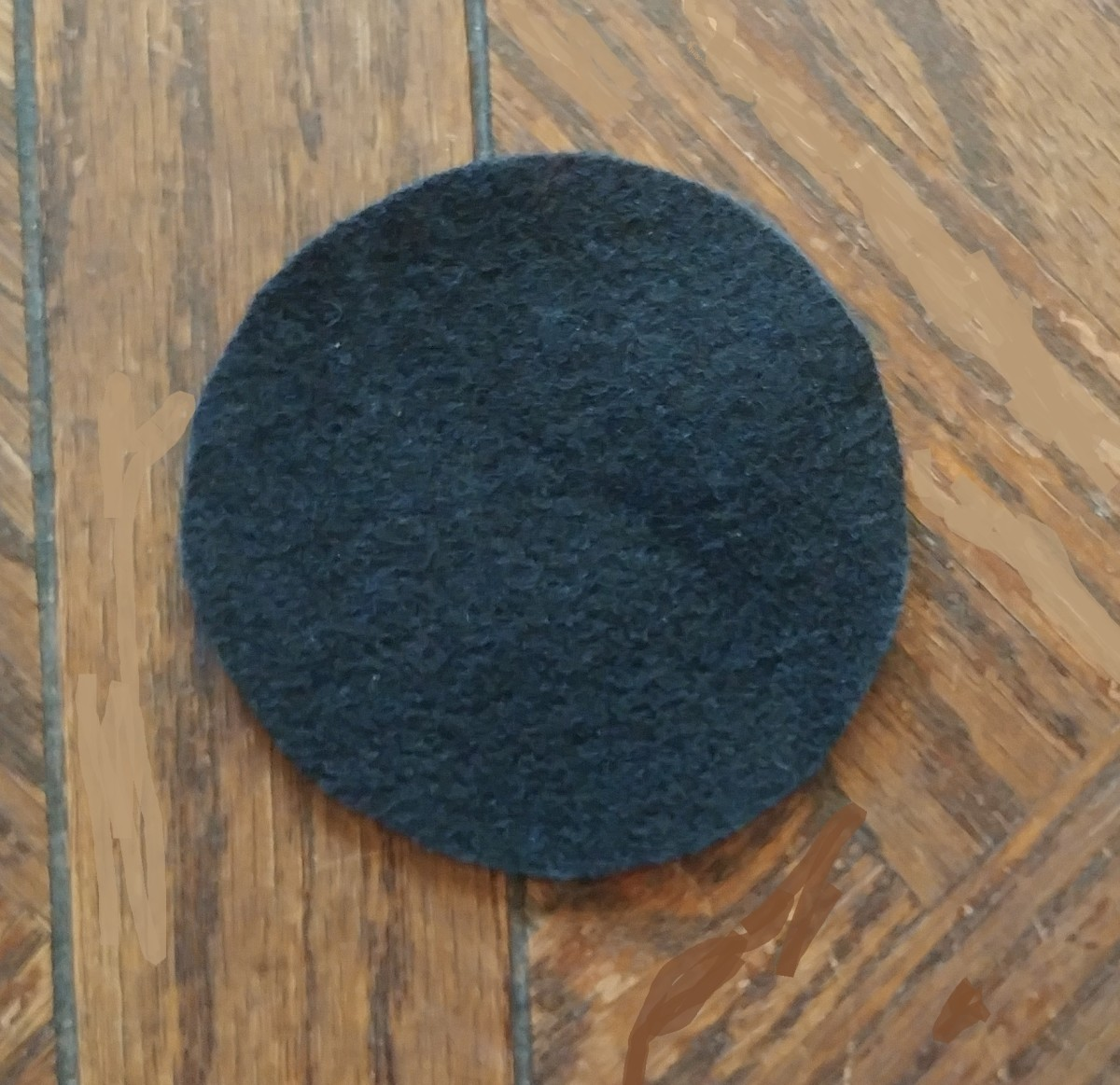 Cut a circle out of black felt. A mason jar lid is a good size to measure the shape.