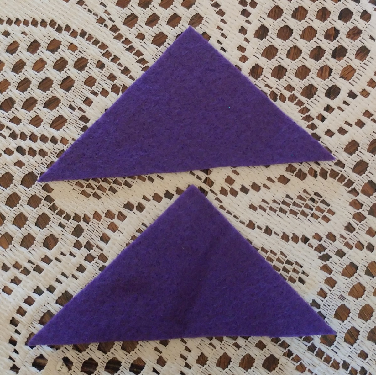 These triangles measure three and a quarter inches from top point.