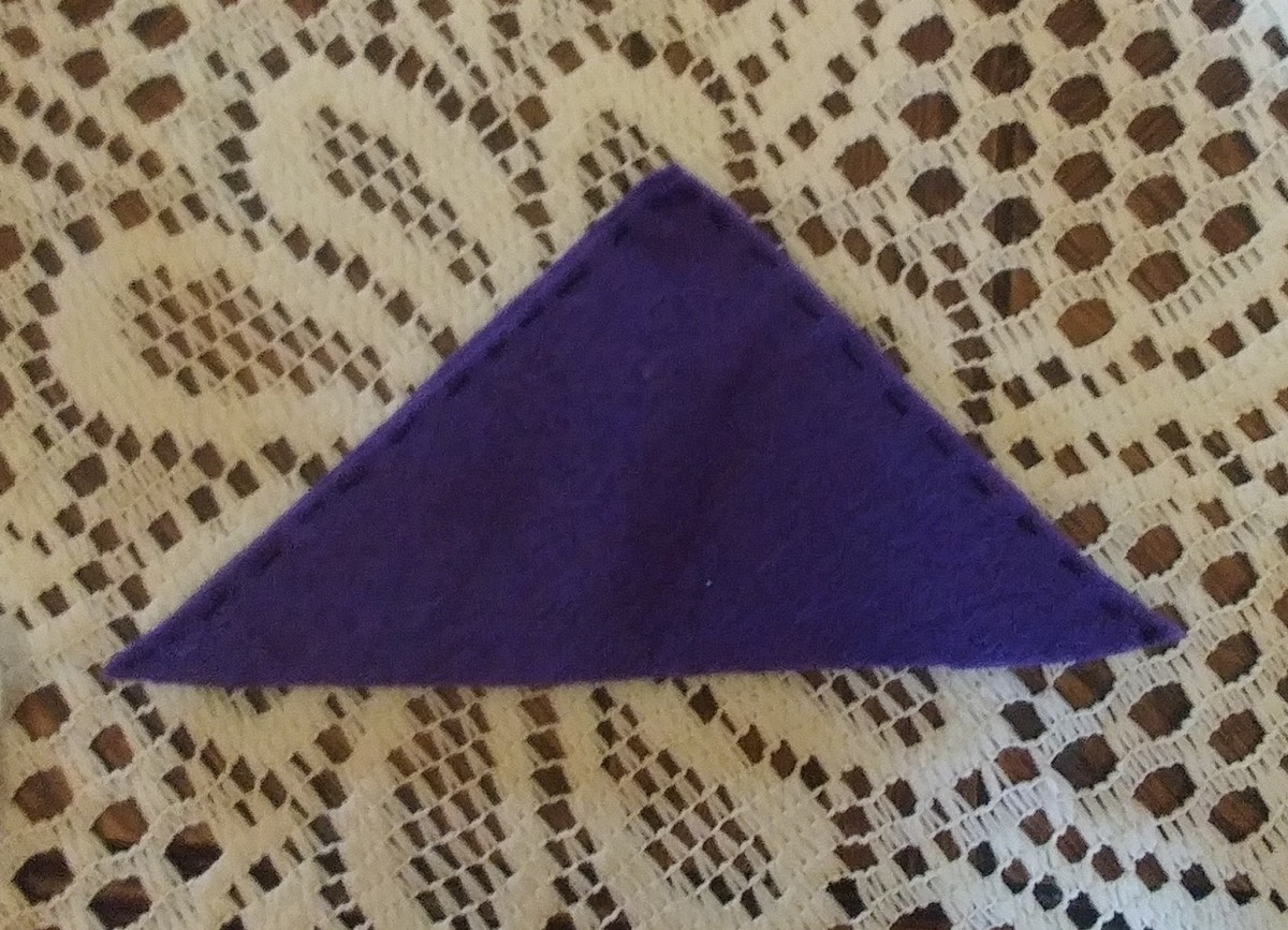Sew top two sides of triangles together. Be sure to leave bottom open.