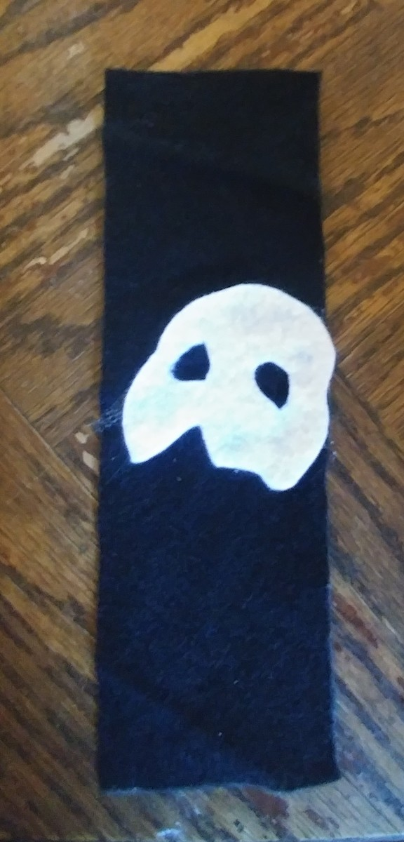 Glue mask on the middle of black felt. I tilted mask a bit, to add style.