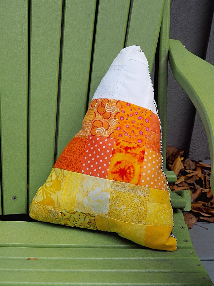 Candy corn throw pillow made out of fabric scraps.