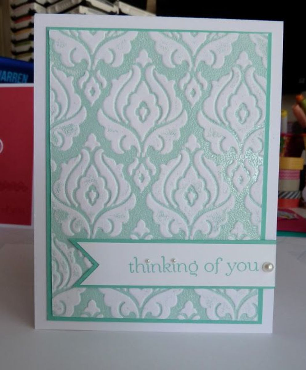 A beautiful, hand-made greeting card that I embossed after I stamped.