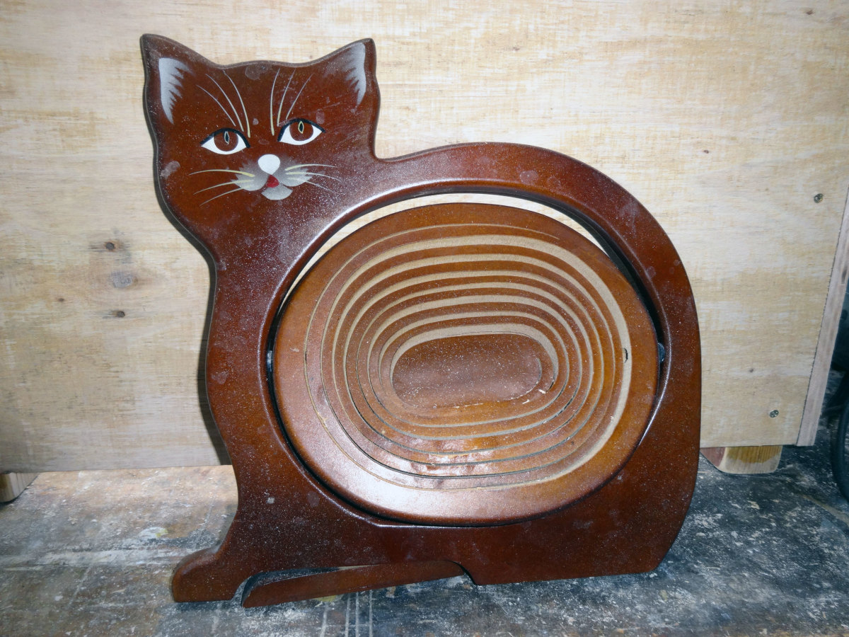 Old broken MDF cat motif fruit bowl.