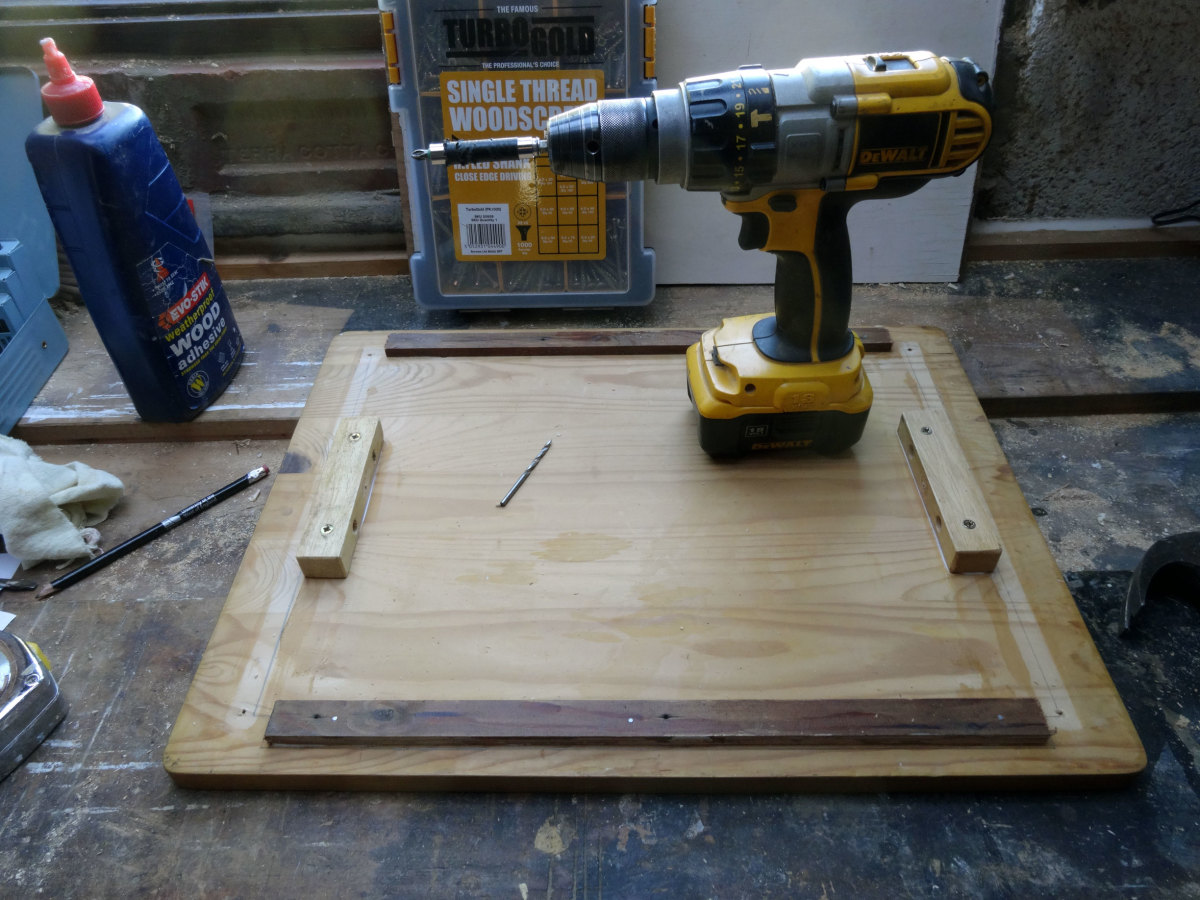 Underside of removable top fitted with wooden blocks to keep it securely in place.
