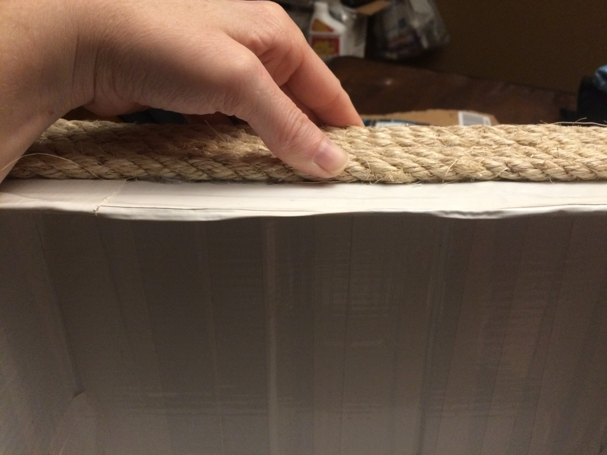 Gluing the rope onto the form.