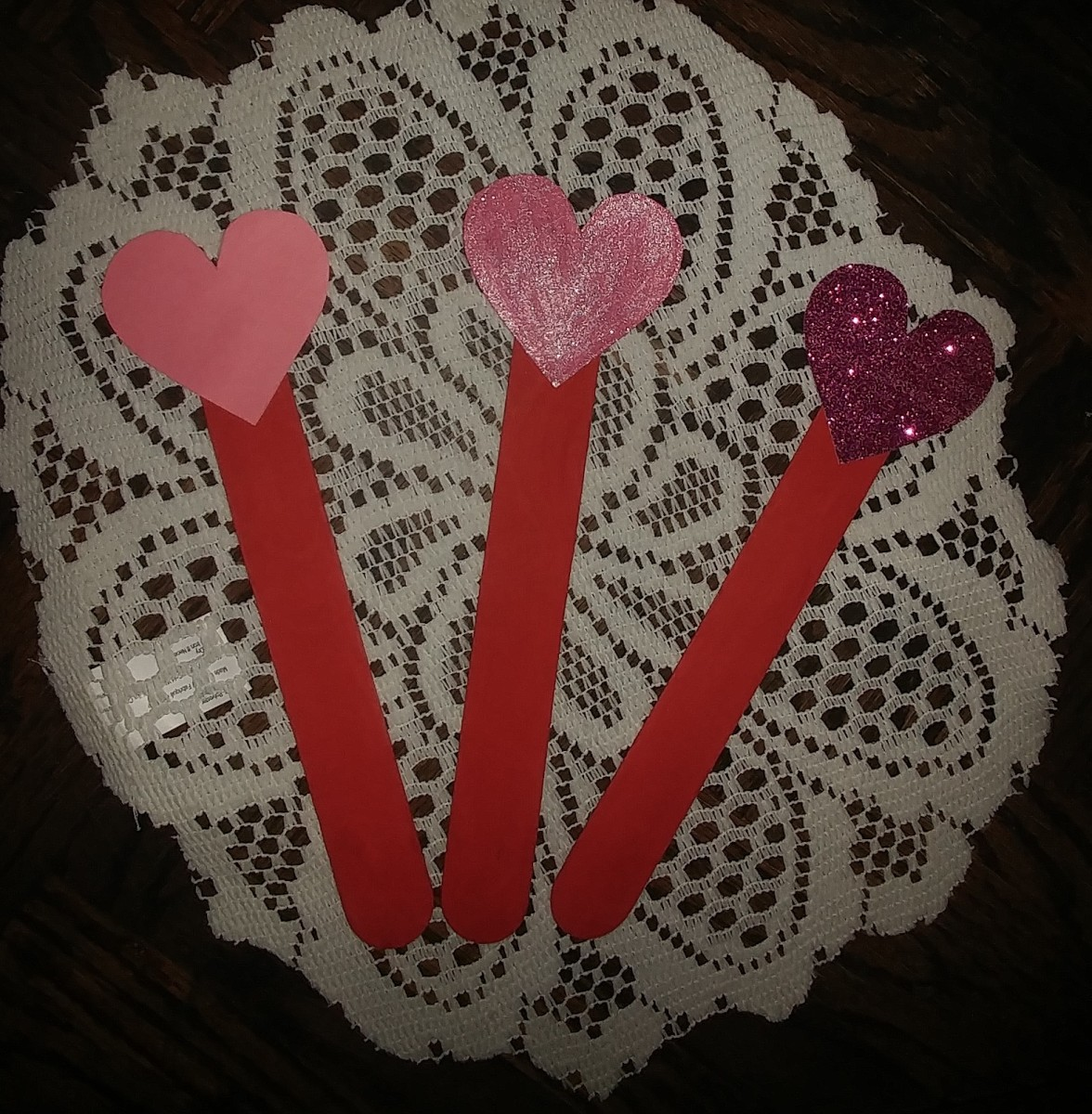 lollipop heart crafts can be used as a festive decoration. Tied to a box of chocolates personalizes a valentine gift.