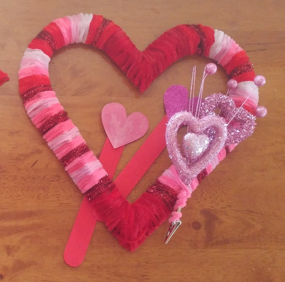 On this wreath I added shiny hearts. See's candy or lollipops can be added to the wreath as well!