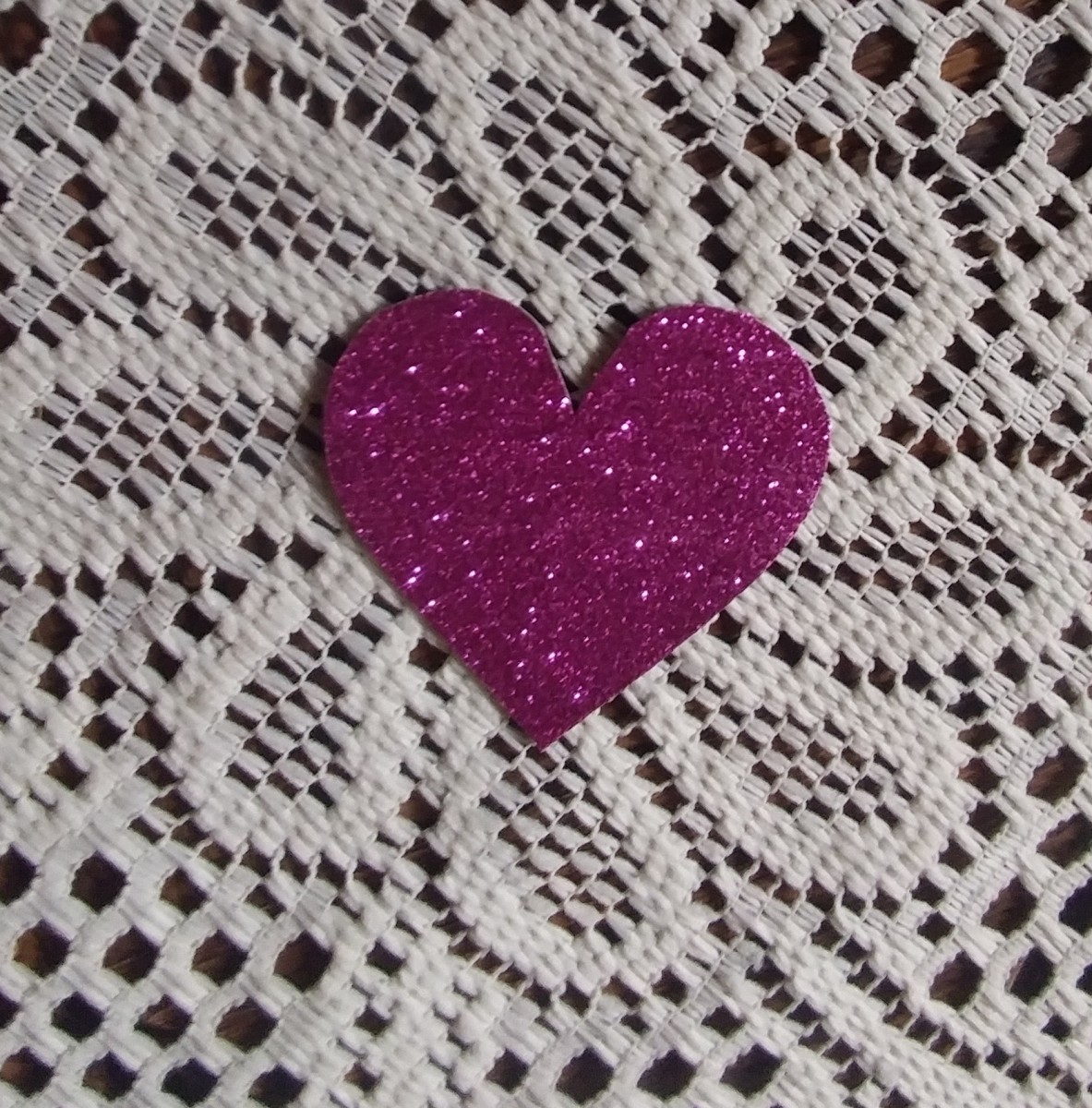I used shiny paper to cut this heart out.