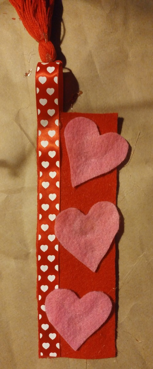 Glue hearts on the front of bookmark.