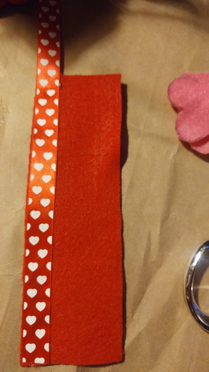 Glue ribbon on the front edge of bookmark.