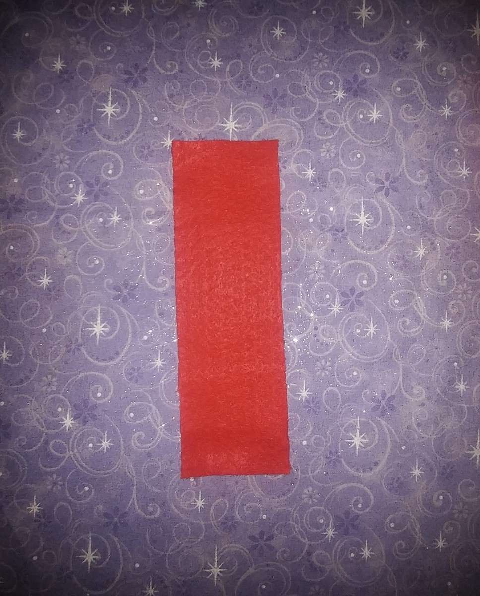 Cut a piece of red in the shape of a bookmark.