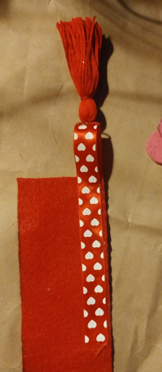 Glue rest of ribbon on the back of bookmark.