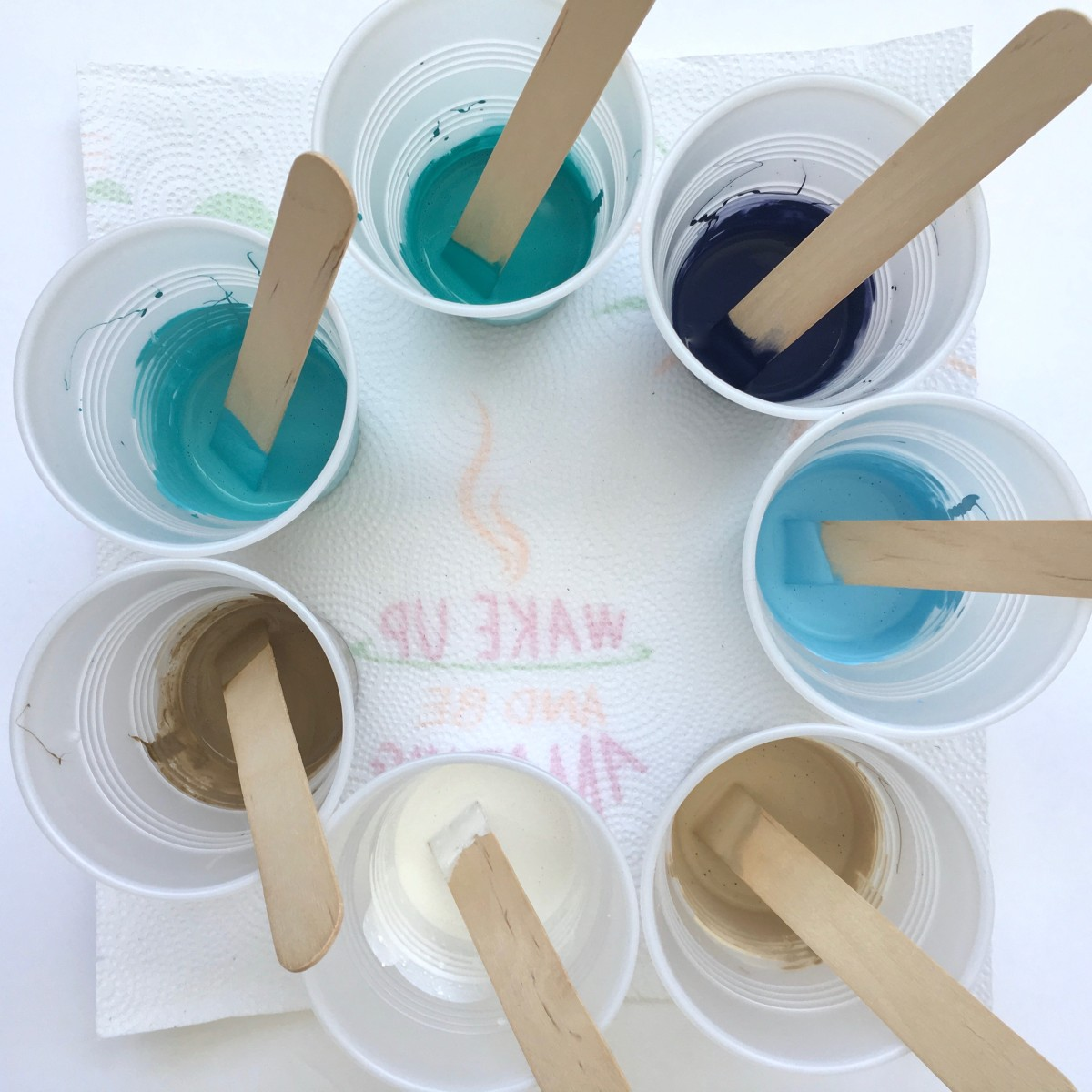 Cups of paint with glue
