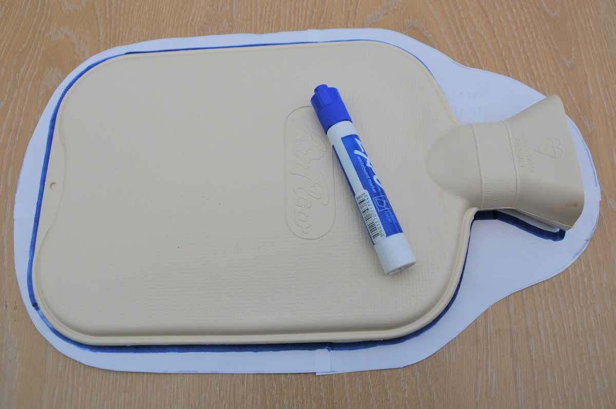 Draw around the hot water bottle with a felt tip pen.