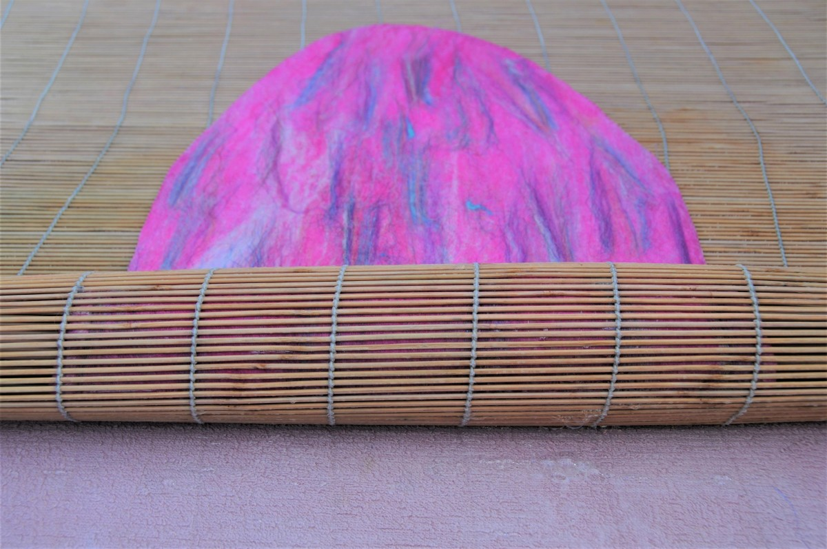 Roll the project loosely inside a large bamboo blind.  Roll very gently at first so as not to displace the fibers.