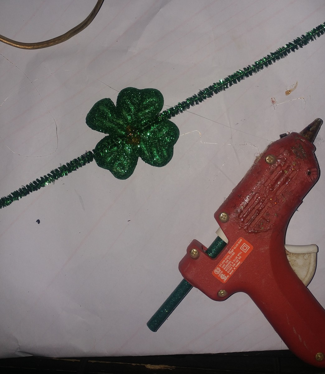 Hot glue shamrock on shiny fuzzy stick.