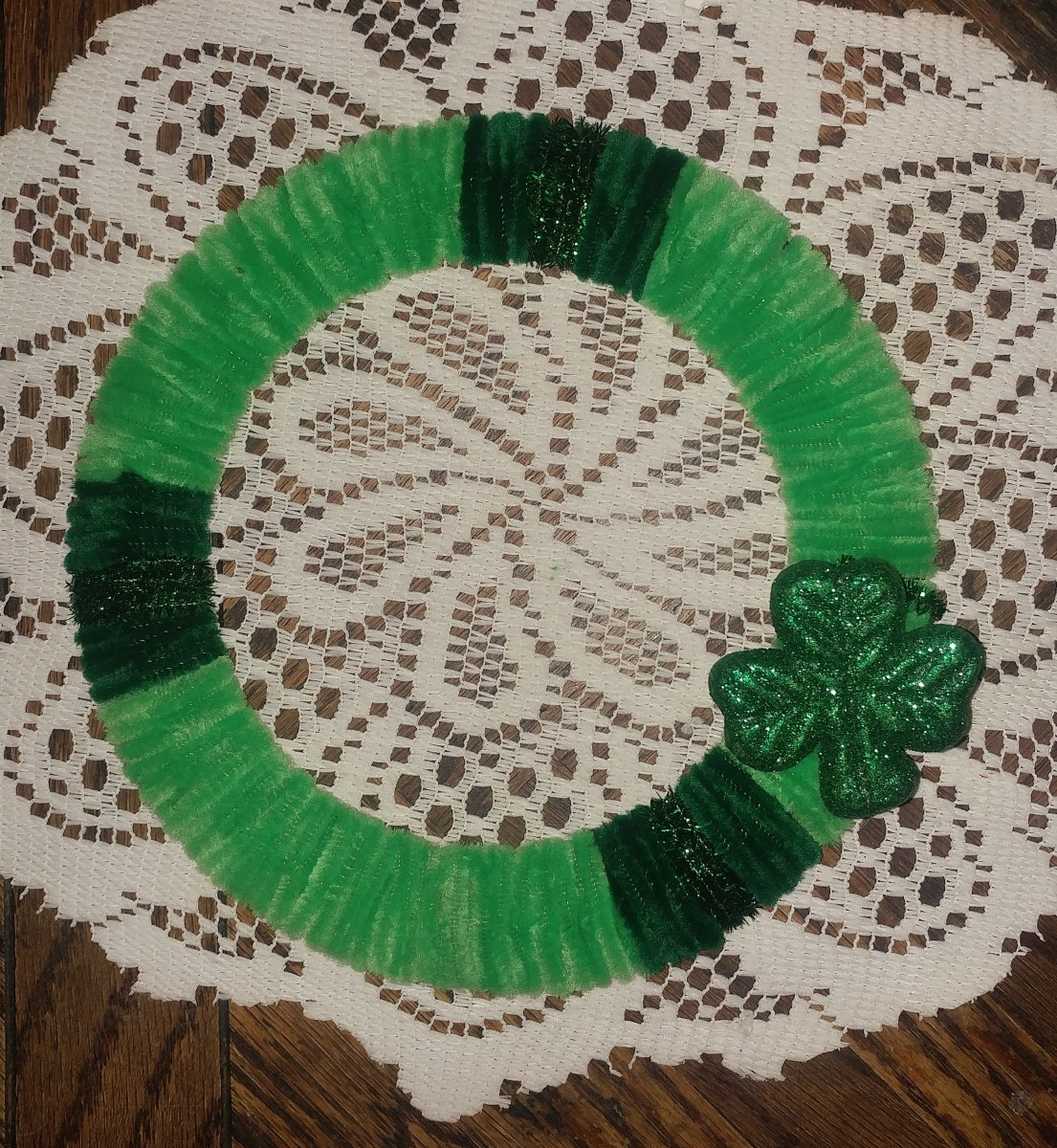 Wrap shamrock around wreath.