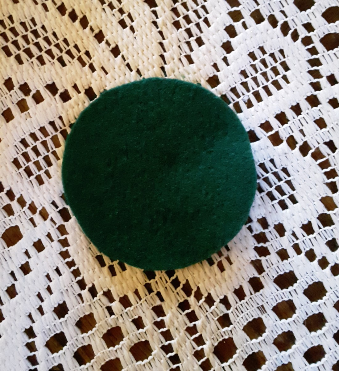 Cut green craft felt to fit inside of lid.