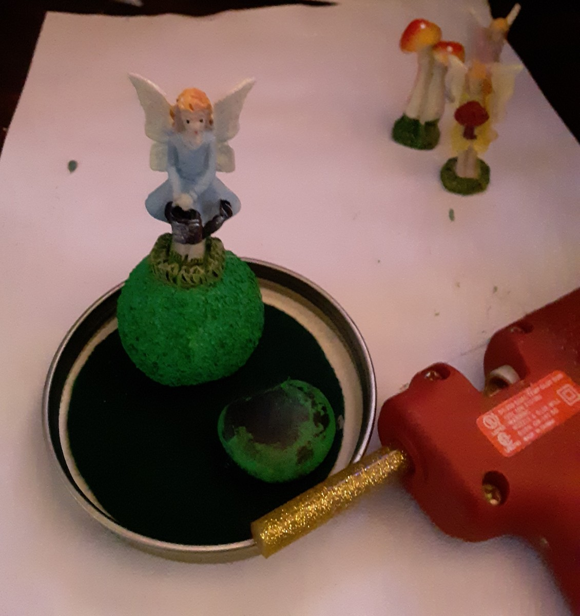 Glue fairy to the top of foam ball.