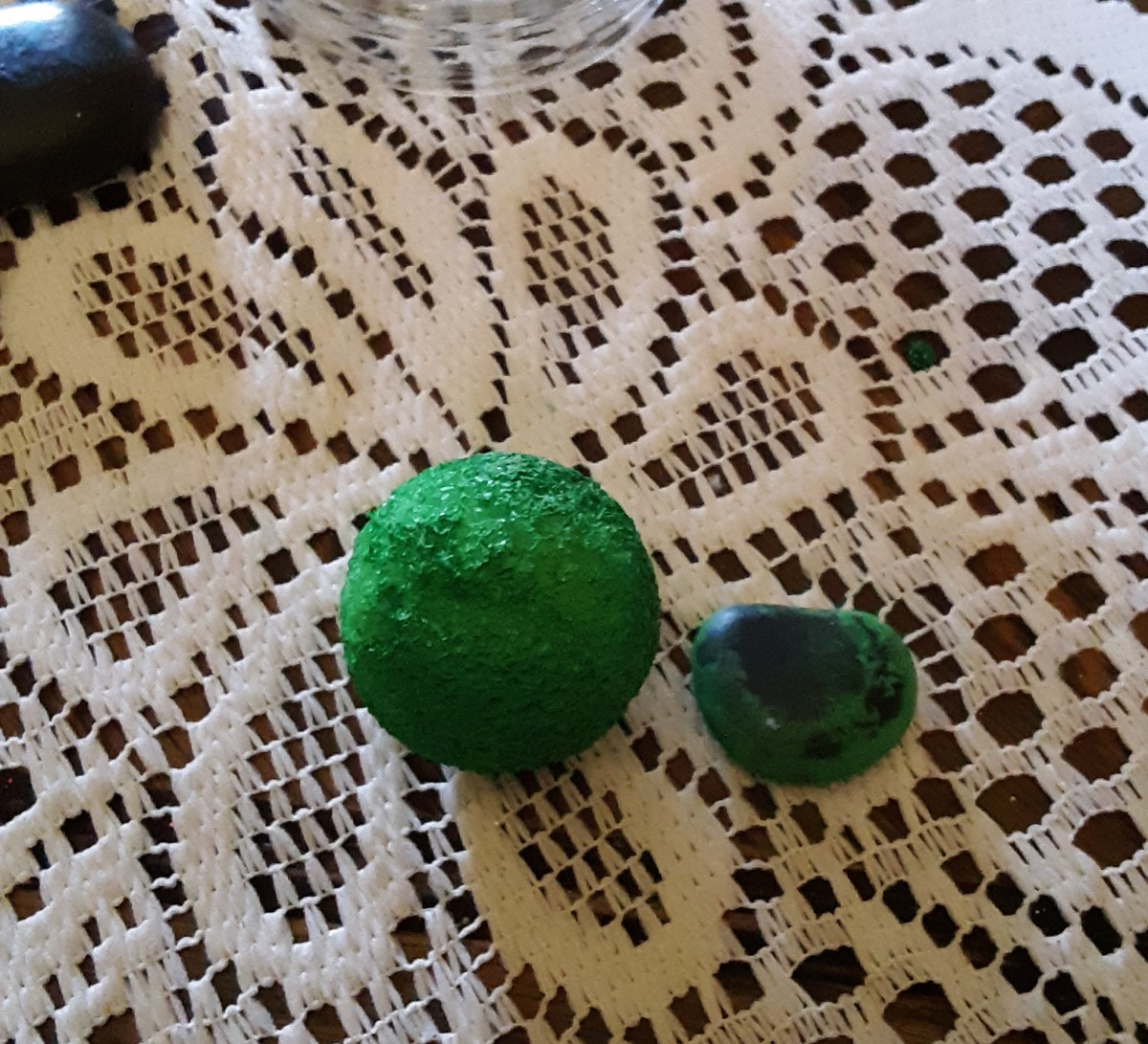Paint foam ball and rock green.