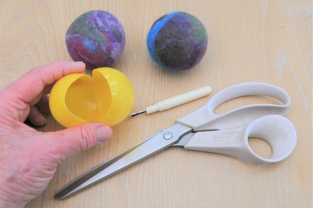 To make small balls, use plastic water play balls which should be cut open as shown.  Leave a quarter of the ball intact.