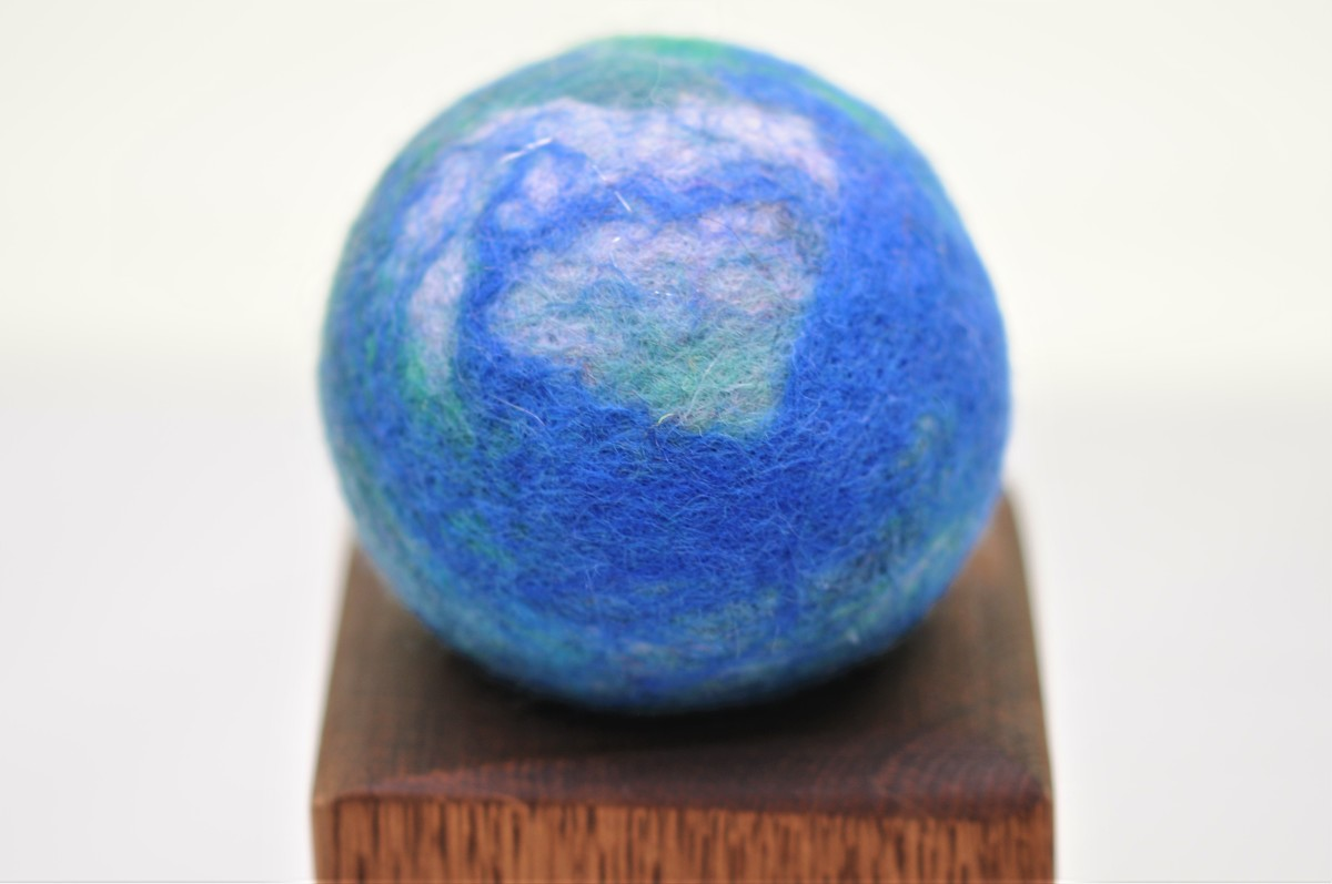 Close-up of the world globe pincushion