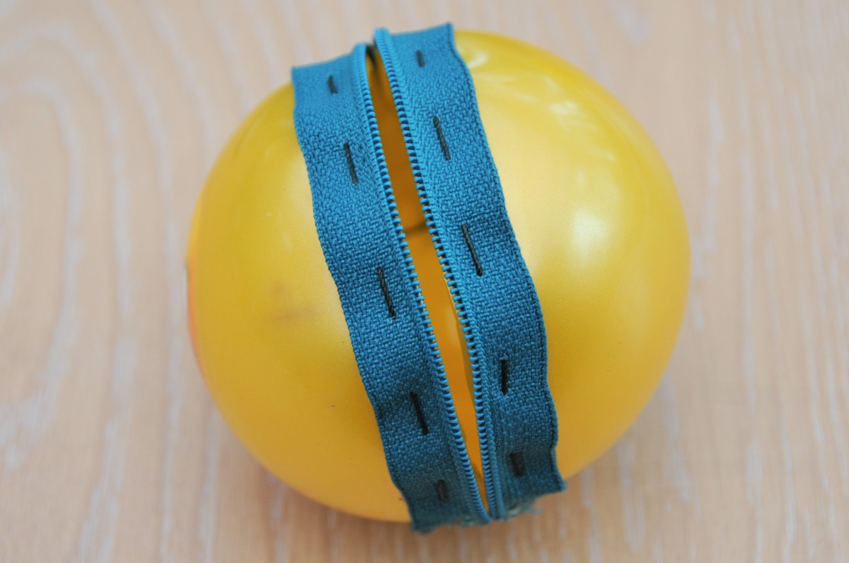 The ball sliced between the zip's teeth