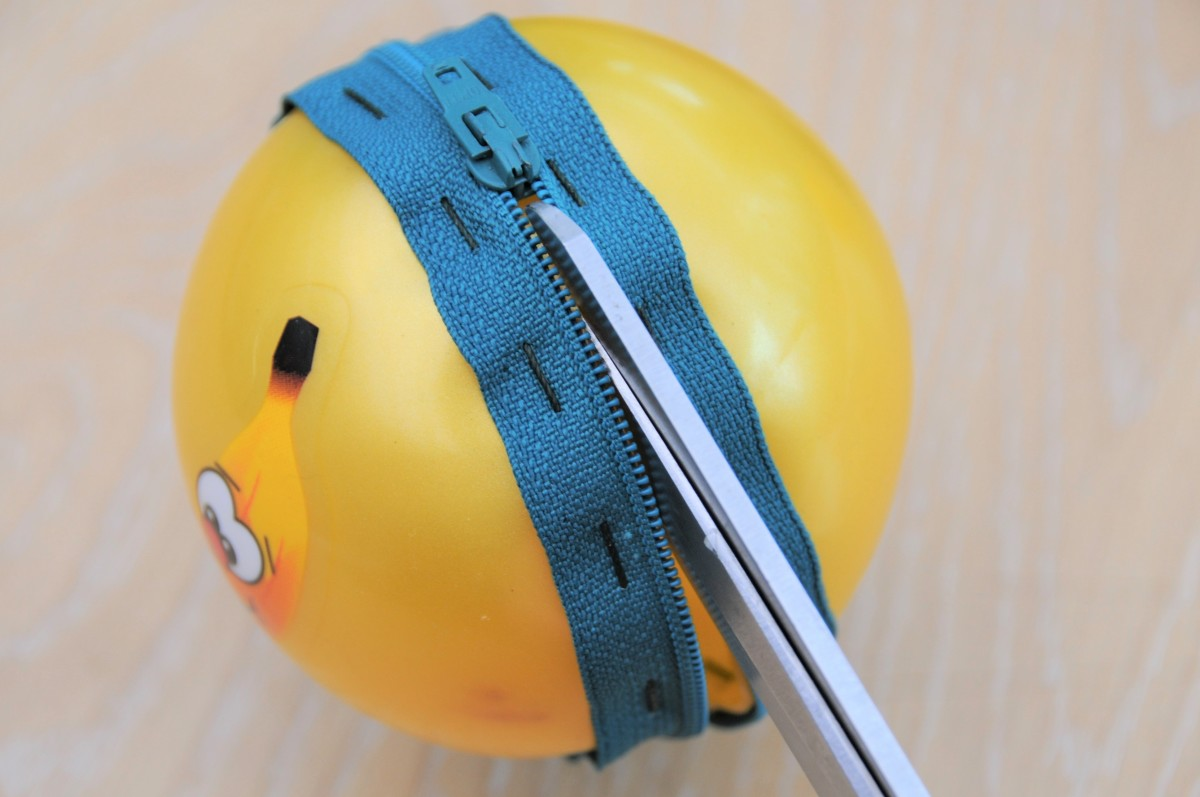 Cut the ball open between the zip opening.
