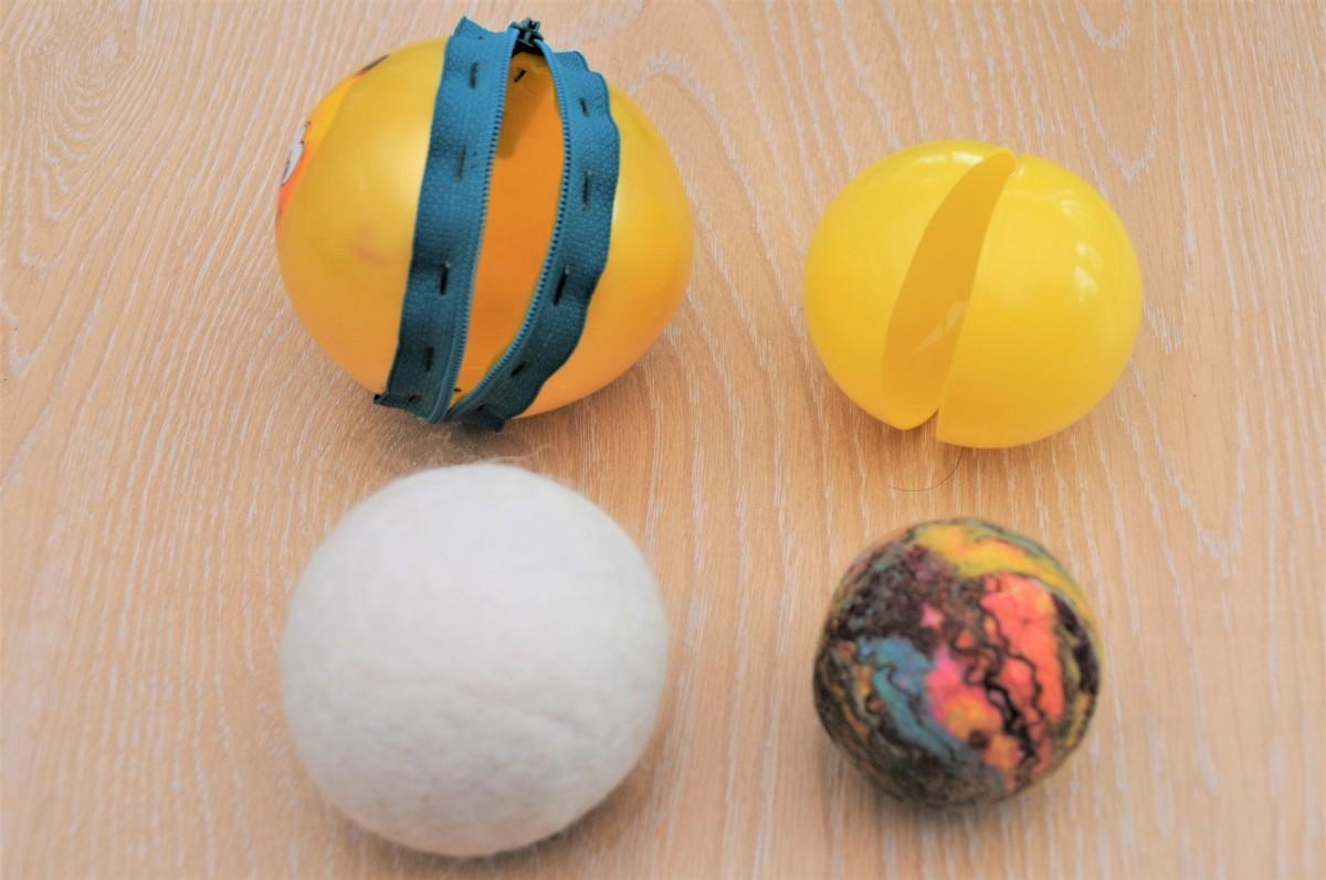 A white dryer ball and a layered Geodie ball.