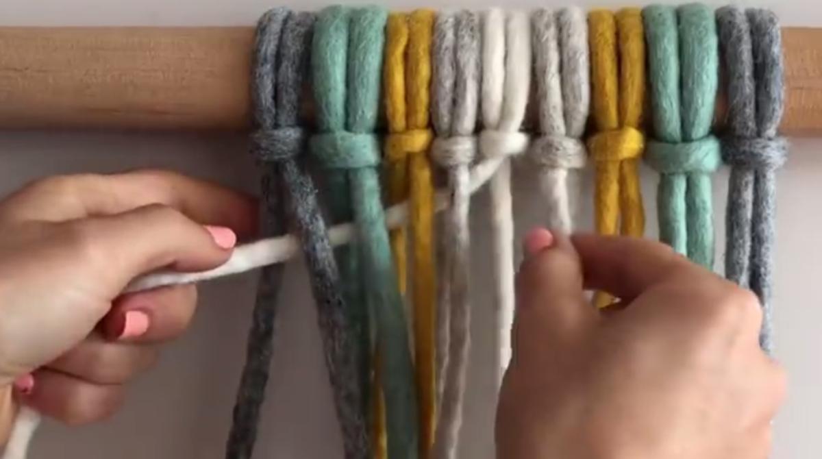 Weave the white strand.