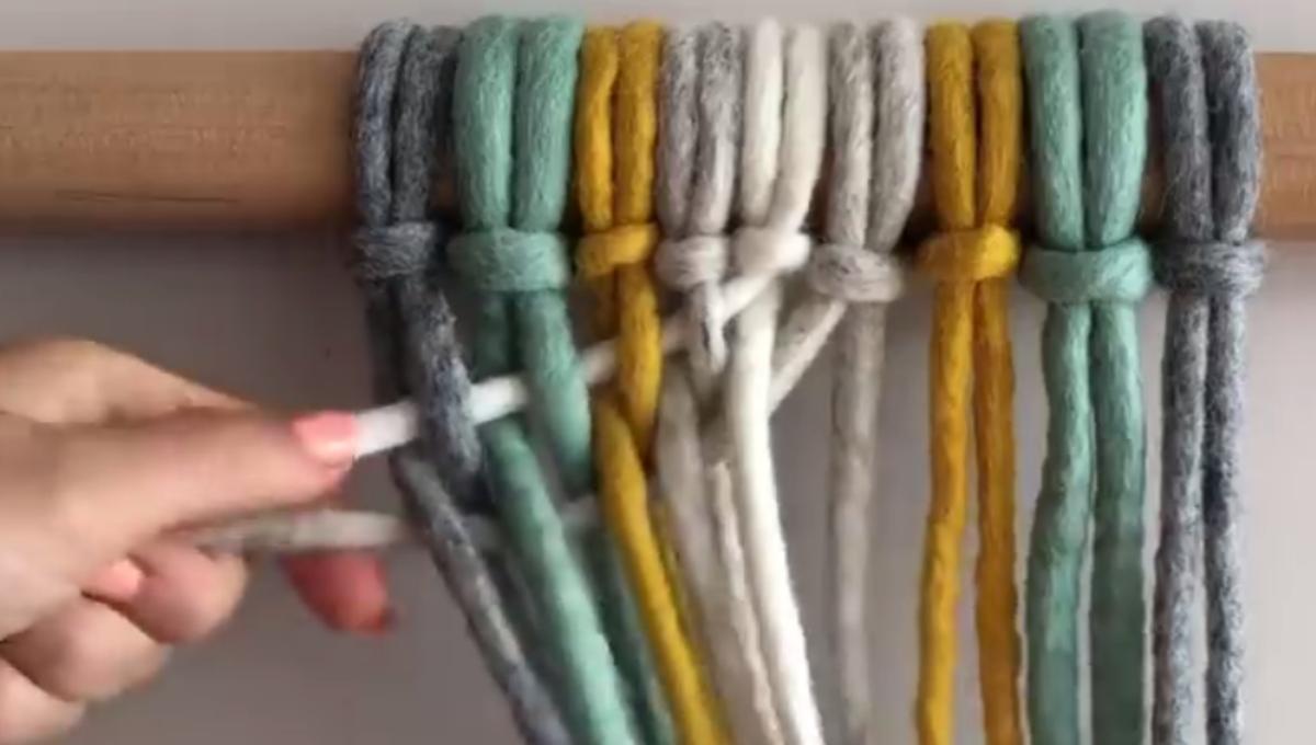 Weave the light gray strand.