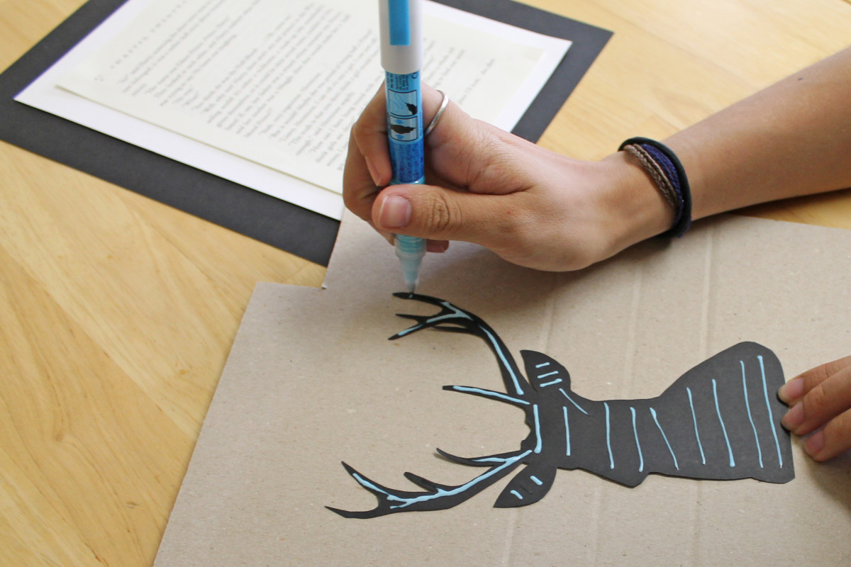 Once your silhouette is cut, flip it over and apply the glue.