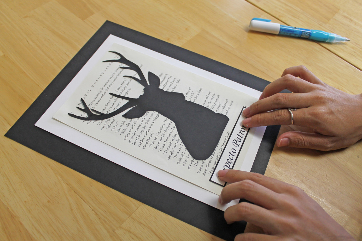 Glue the silhouette to the center of the book page. Then glue the word you cut out beneath it.