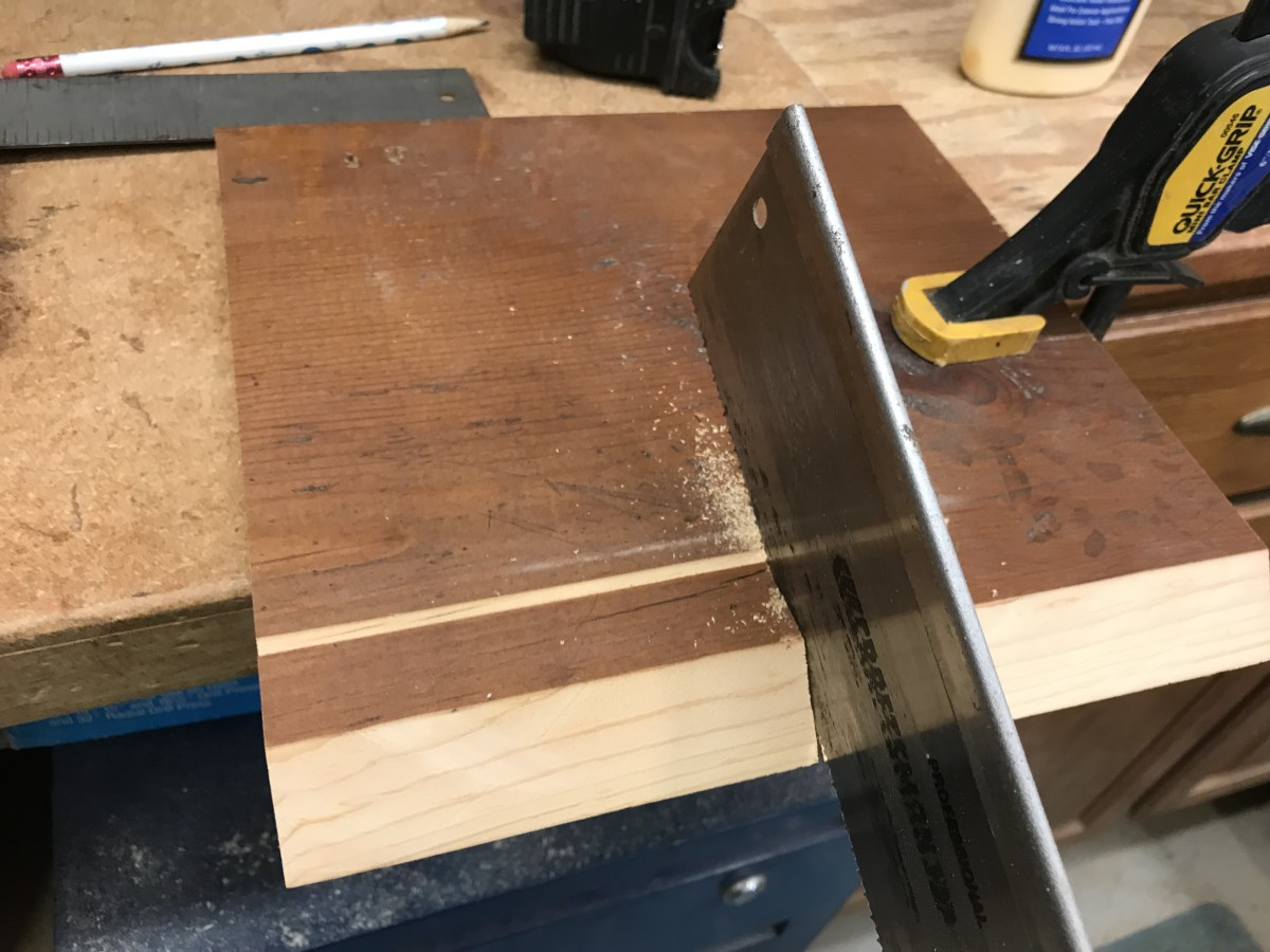 Use a small hand saw to finish the cut